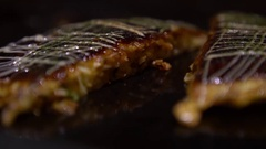 4K Cooking an Okonomiyaki Japanese food with sweet sauce Soya and mayonnaise-Dan Stock Footage