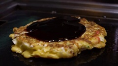 Slow Motion Put sauce Soya to Okonomiyaki Japanese food. Cooking Monjayaki -Dan Stock Footage