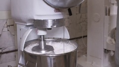 Industrial planetary mixer whipping marshmallow mixture into a foam Stock Footage
