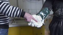 Eating marshmallow fluff with hands at confectionery factory Stock Footage