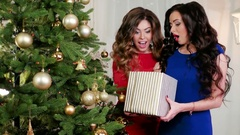 Amazing Christmas gift, girls celebrate the new year, consider a gift, happy Stock Footage