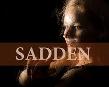 Sadden written on virtual screen. hand of young woman melancholy and sad at the Kuvituskuvat