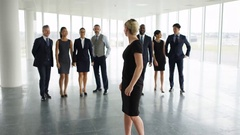 4K Portrait happy multiracial business team in large open plan office Stock Footage