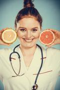 Happy dietitian nutritionist with grapefruit. Stock Photos