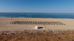 Shooting from the sky Falésia beach, sun beds for tourists in the summer in Stock Footage