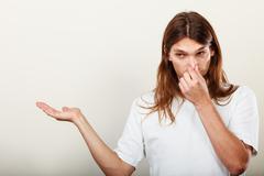 Man with odor of sweat Stock Photos