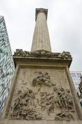 The Monument in the City of London - important tourist attraction Stock Photos