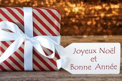 Atmospheric Christmas Gift With Label, Bonne Annee Means New Year Stock Photos