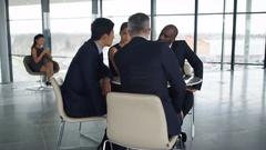 4K Corporate business team in informal meeting in large open plan office Stock Footage