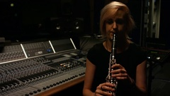 Woman playing a clarinet Stock Footage