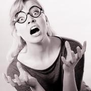 Furious woman yelling. Stock Photos