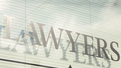 Lawyers sign bright Stock Footage