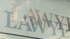 Lawyers sign pan right close up Stock Footage