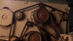 Close-up view of rotating gears on running machine Stock Footage