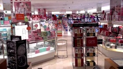 Macys cosmetics perfume counters, escalator view Stock Footage