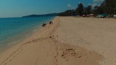 Flying close to the horses on the Bang Tao beach. Phuket. Thailand. Aerial view. Stock Footage
