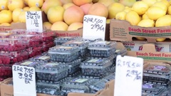 Blueberries for sale fruit stand Stock Footage