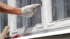 Worker Scraping Old Paint From House Stock Footage