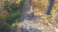 Mother with baby walking outdoor. Top view, dron helicopter. Autumn Stock Footage