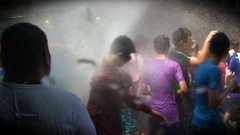 The celebration of Songkran and pouring on the streets of Bangkok. Thailand. Arkistovideo