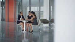 4K Female business team in informal meeting in office breakout area Stock Footage