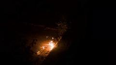Sparkler Burning on Sidewalk Stock Footage