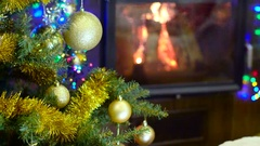 Christmas tree in front of fireplace Stock Footage