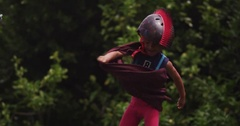 A young superhero battles his archnemesis in the park. slow motion. Stock Footage