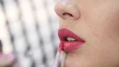 Close-up of making fashion pink lips makeup. Stock Footage