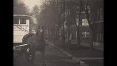 Vintage 16mm film, 1929 milkman cart and horse on street Stock Footage