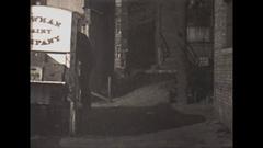 Vintage 16mm film, 1929, milkman delivering milk from horsedrawn milk wagon Stock Footage