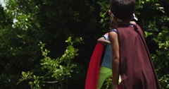 Children playing pretend face off for an epic make believe battle. slow motion. Stock Footage