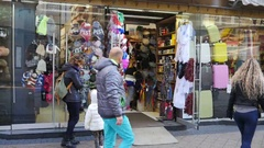 Budapest Hungary people shopping watch souvenirs in showcase frontage store Stock Footage