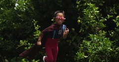 Kids pretend to be superheroes in the park. slow motion. Stock Footage