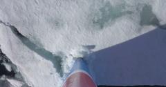 Prow Ship breaks ice in the sea of Spitsbergen Norway Stock Footage