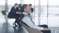 4K Male business team in informal meeting in office breakout area Stock Footage