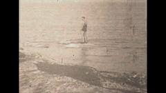 Vintage 16mm film, 1930 Chicago polar bear club swim winter #1, people swim Stock Footage