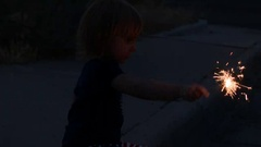 Little Toddler Girl Playing with Sparkler Stock Footage