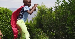 Children do somersaults while playing make believe. Slow motion. Stock Footage