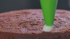 Decorating biscuit chocolate cake. Decoration of confectionery Stock Footage