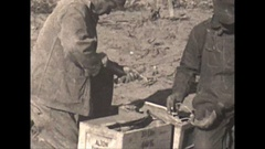 Vintage 16mm film, 1930, men preparing dynamite, setting det cord and charges Stock Footage