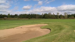 Golfers with bunker pan Stock Footage
