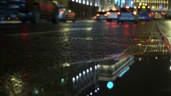 Car Lights Reflect on Rainy Road and Puddles at Night City. Bottom view concept Stock Footage