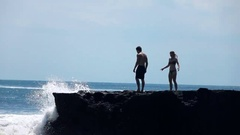 Young couple standing on cliff and admire view,super slow motion 240fps Stock Footage