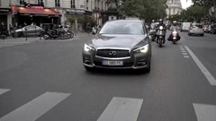 Girl driving luxury car in Paris streets Stock Footage