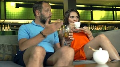 Young, pretty woman listening reproaches with his husband in the bar,4K Stock Footage