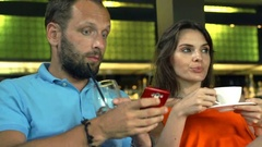 Young, pretty woman listening reproaches with his husband in the bar Stock Footage