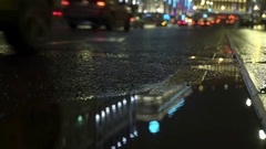 Yellow taxi passes and stops. Car and Traffic Lights Reflect on Rainy Road Stock Footage