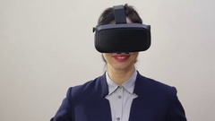 Woman uses a head mounted display. Stock Footage