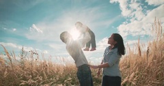 Young Asian family in a field with a baby 1 year on hand, the concept of family Stock Footage